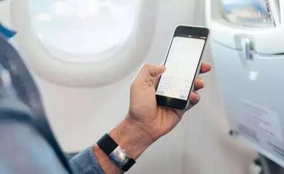 民航局放开禁令 中国航班上可以用手机不远了!