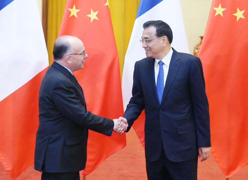 李克强接待法国总理访华:以稳定性应对不确定性