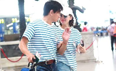 刘诗诗挽手吴奇隆撒娇低语 情侣装牵手对视爱意浓