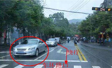 前车坏在路口怎么办,实线变道也算违章?