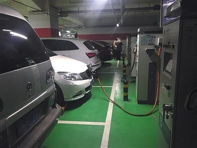 居住区停车位安装充电桩比例应不低于18%.