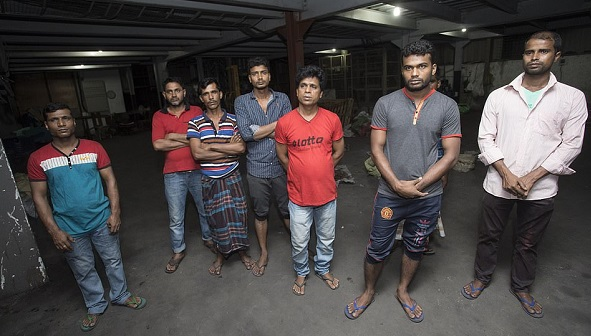 12623264-0-A_group_of_men_who_work_at_the_Copper_factory_that_was_raided_by-a-22_1556037869297.jpg