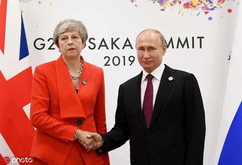 特蕾莎·梅与普京会晤场面尴尬 英媒:她表情粗鲁无
